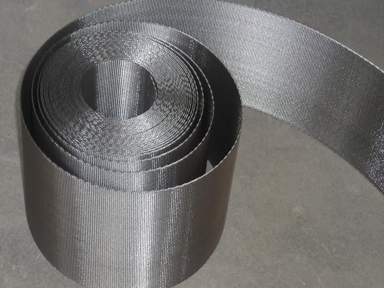 A roll of stainless steel extruder screen belt on the ground with bright color.