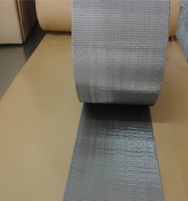 A roll of reverse dutch weave stainless steel extruder screen belt on the table.
