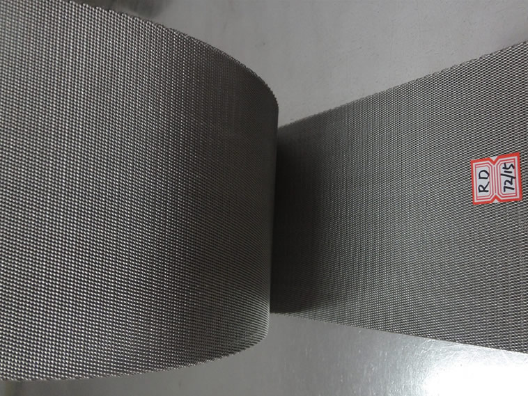 A roll of reverse dutch weave stainless steel extruder screen belt with label on it.